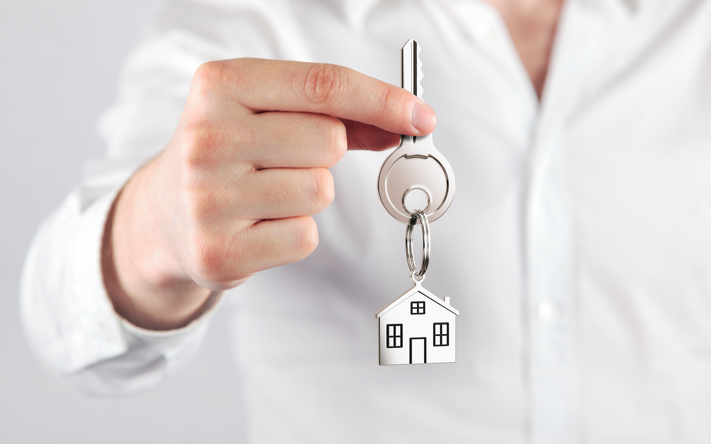giving house key with a keychain house form